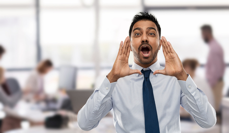 business, emotion and people concept - indian businessman shouting or calling over office background