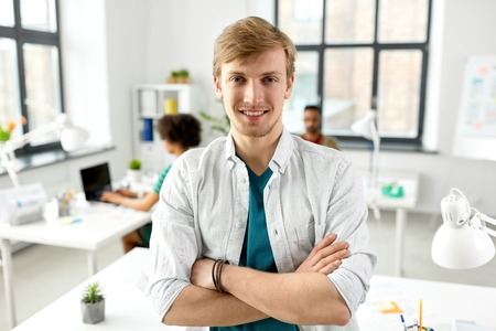 man with crossed hands at office Stock Photo