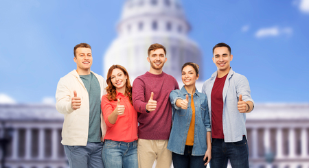 friends showing thumbs up over capitol building