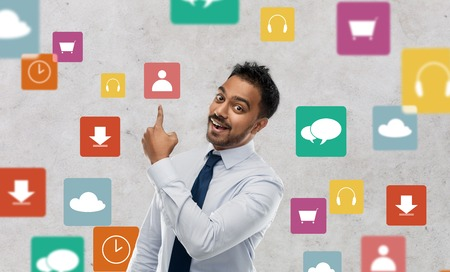indian businessman pointing finger at app icons