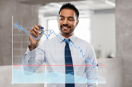 businessman with marker drawing chart at office
