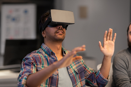 deadline, augmented reality and technology concept - creative man with virtual headset or 3d glasses at office 写真素材
