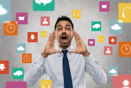 indian businessman shouting over app icons