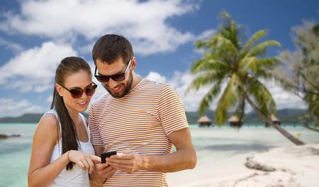 happy couple with smartphone in summer Stock fotó