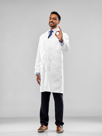 indian doctor or scientist showing ok