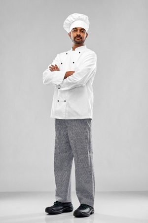 male indian chef in toque