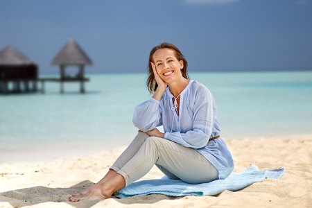 happy woman over tropical beach and bungalow