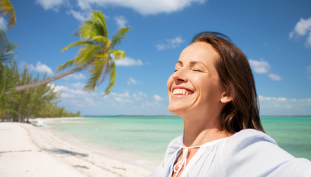 happy woman over tropical beach background