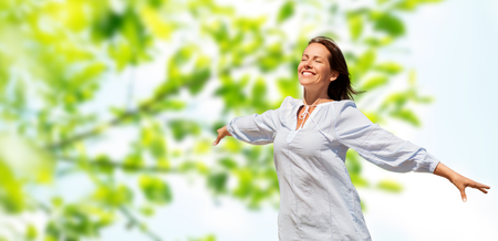 happy smiling woman over green natural background