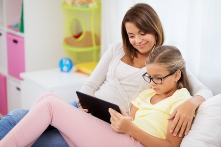 happy mother and daughter with tablet pc at home Stok Fotoğraf