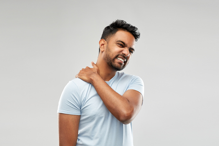 unhealthy indian man suffering from neck pain Stock Photo - 116498000