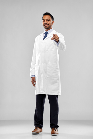 smiling indian doctor or scientist pointing to you Stock Photo