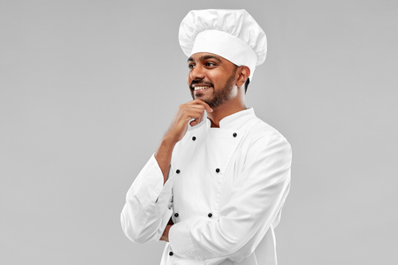 happy male indian chef in toque 免版税图像