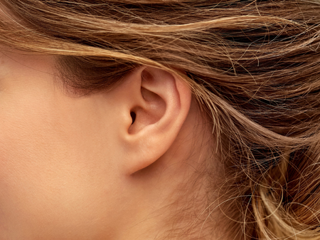 close up of young woman face from ear side