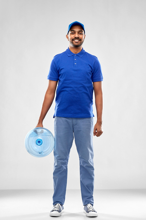 happy indian delivery man with water barrel