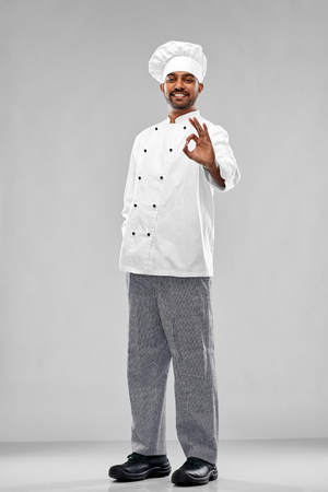 happy male indian chef in toque showing ok gesture Stock Photo