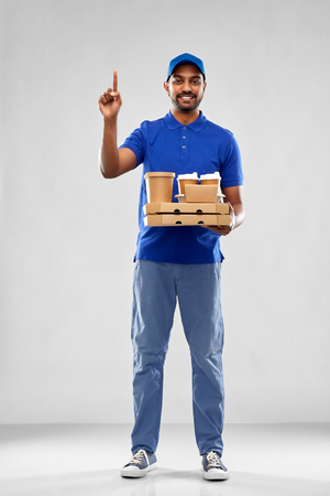 happy indian delivery man with food and drinks