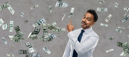 indian businessman pointing finger at money