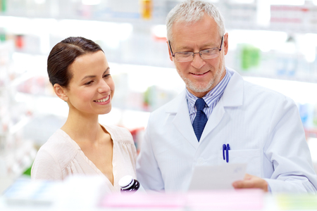 apothecary and woman with drug at pharmacy Stock fotó