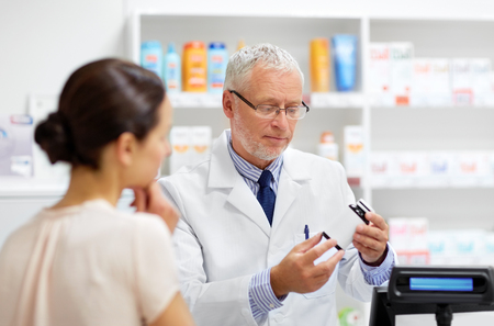 apothecary with cure and customer at pharmacy