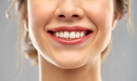 close up of smiling woman face with white teeth 免版税图像