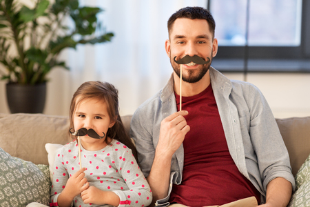 father and daughter with mustaches having fun