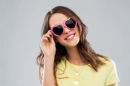 teenage girl in heart-shaped sunglasses Stockfoto