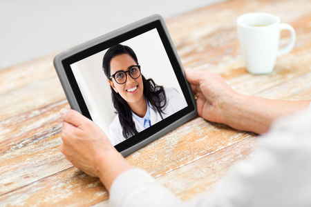 senior woman patient having video call with doctor