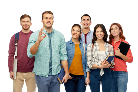 group of smiling students showing ok hand sign