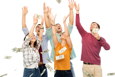 happy friends picking money falling from up above Stock Photo