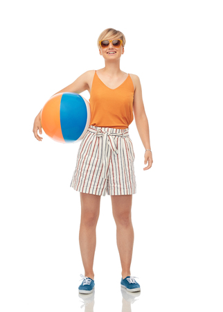 smiling teenage girl in sunglasses with beach ball Imagens