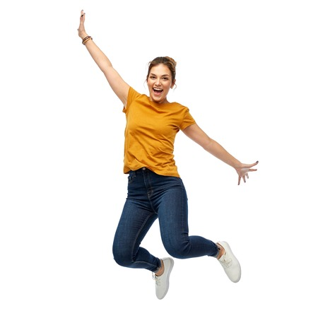 happy young woman or teenage girl jumping 免版税图像