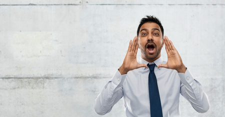 indian businessman calling someone over concrete