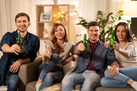 friends toasting non-alcoholic beer at home