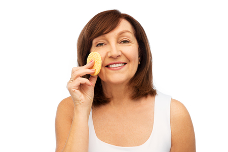 woman cleaning face with exfoliating sponge Stock Photo
