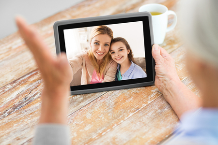 family having video call on tablet computer