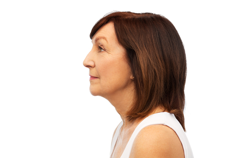 profile of senior woman over white background Banque d'images