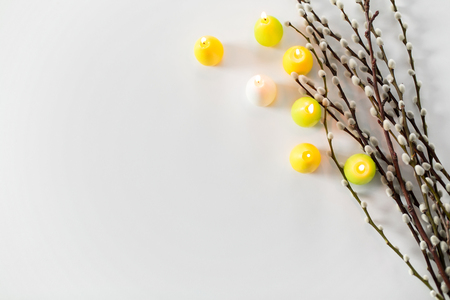 pussy willow branches and easter egg candles Stock Photo