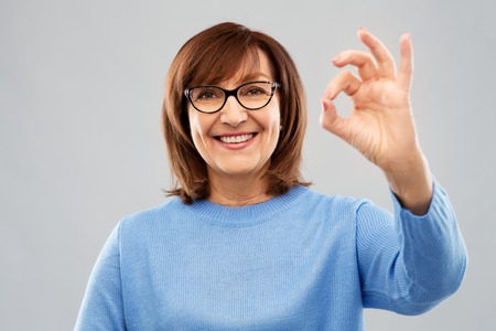 happy senior woman in glasses showing ok hand sign Stock Photo