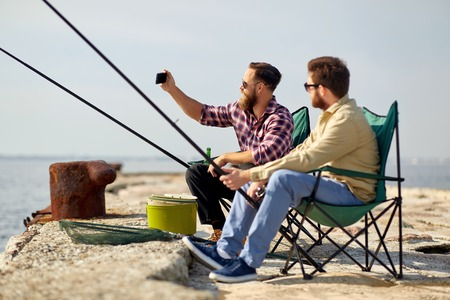 friends fishing and taking selfie by smartphone Stock fotó