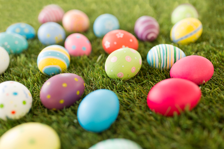 colored easter eggs on artificial grass