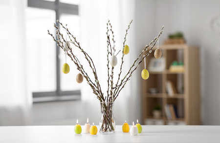 pussy willow branches decorated by easter eggs Stock Photo