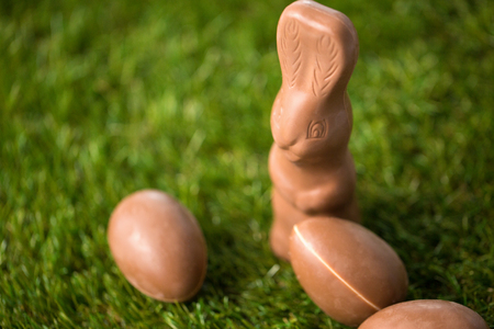 close up of chocolate bunny and easter eggs