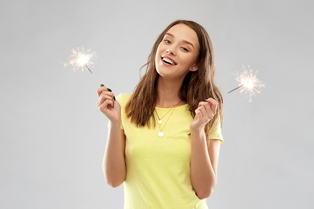 happy teenage girl with two sparklers Stock Photo