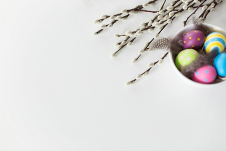 colored easter eggs and pussy willow branches