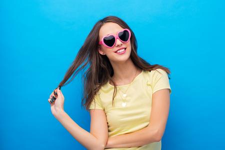 teenage girl in heart-shaped sunglasses Imagens