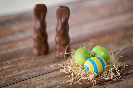 easter eggs in straw nest and chocolate bunnies