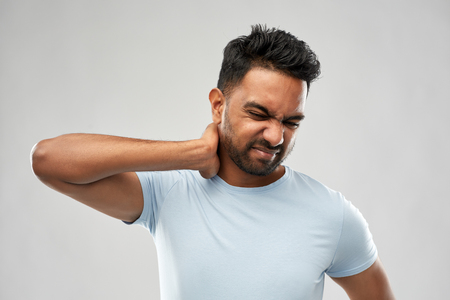 unhealthy indian man suffering from neck pain Stock Photo - 118429136