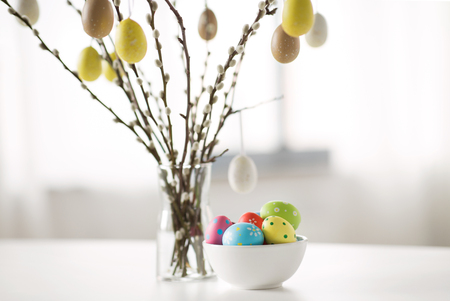 pussy willow branches decorated by easter eggs 스톡 콘텐츠