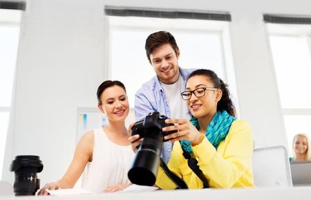 photographers with camera at photo studio Imagens
